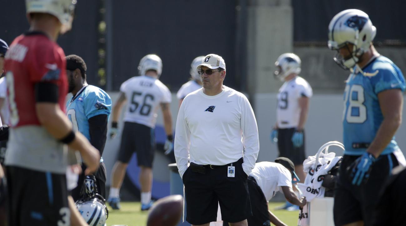 Carolina Panthers head coach Ron Rivera watches the team during an NFL football practice in Charlotte, N.C., Thursday, June 16, 2016. (AP Photo/Chuck Burton)