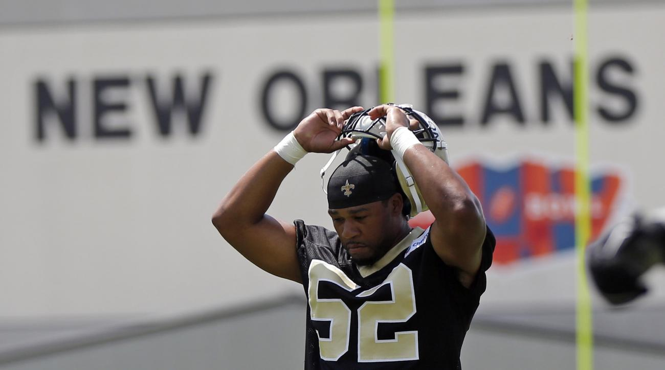 New Orleans Saints linebacker Craig Robertson (52) takes part in a drill during the NFL football team's minicamp in Metairie, La., Thursday, June 16, 2016. (AP Photo/Gerald Herbert)