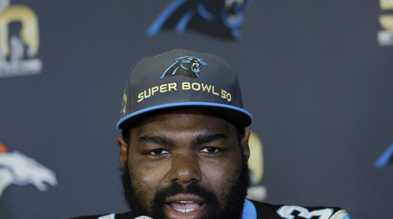 Carolina Panthers tackle Michael Oher answers questions during a press conference Tuesday, Feb. 2, 2016 in San Jose, Calif. Carolina plays the Denver Broncos in the NFL Super Bowl 50 football game Sunday, Feb. 7, 2015, in Santa Clara, Calif. (AP Photo/Mar