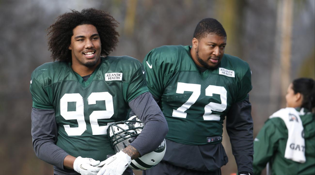FILE - In this  Dec. 9, 2015, file pho, New York Jets defensive end Leonard Williams (92) and defensive end Stephen Bowen (72) watch during NFL football practice in Florham Park, N.J. The big defensive lineman showed flashes of what made him the No. 6 ove