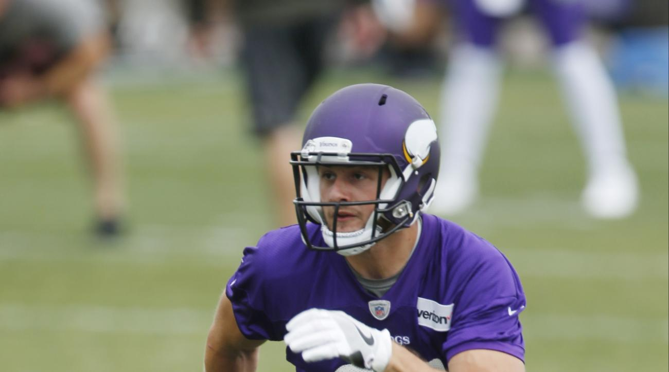 FILE - In this June 14, 2016, file photo, Minnesota Vikings rookie wide receiver Moritz Boehringer, of Germany, runs a route during drills at the NFL football team's minicamp in Eden Prairie, Minn. Boehringer's size and speed captured the attention of the