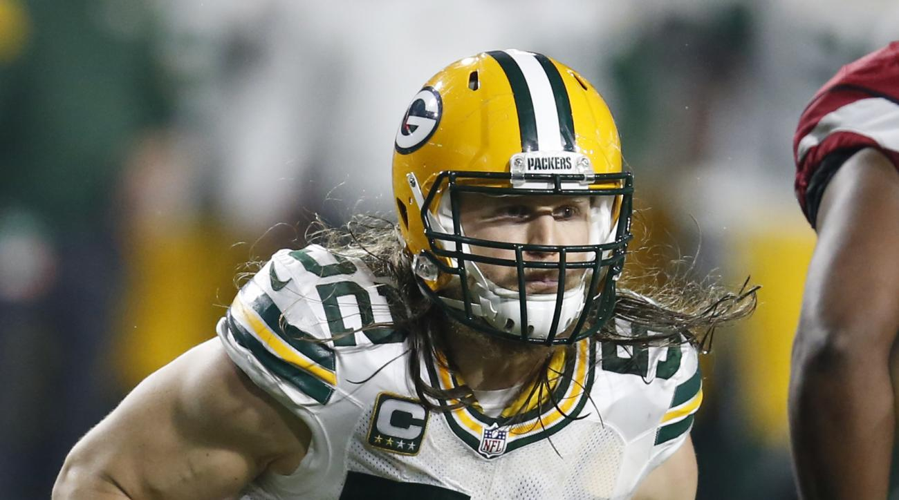 FILE - In this Jan. 16, 2016, file photo, Green Bay Packers inside linebacker Clay Matthews (52) chases a play during an NFL divisional playoff football game against the Arizona Cardinals, in Glendale, Ariz. Matthews, Julius Peppers and James Harrison wil