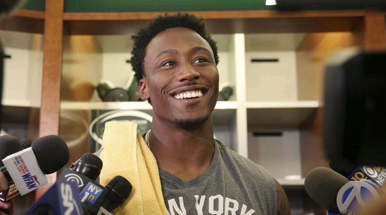 FILE - In this June 1, 2016, file photo, New York Jets wide receiver Brandon Marshall answers a question as he stands in the locker room after NFL football practice in Florham Park, N.J. Marshall is serving up some rather interesting, if not particularly