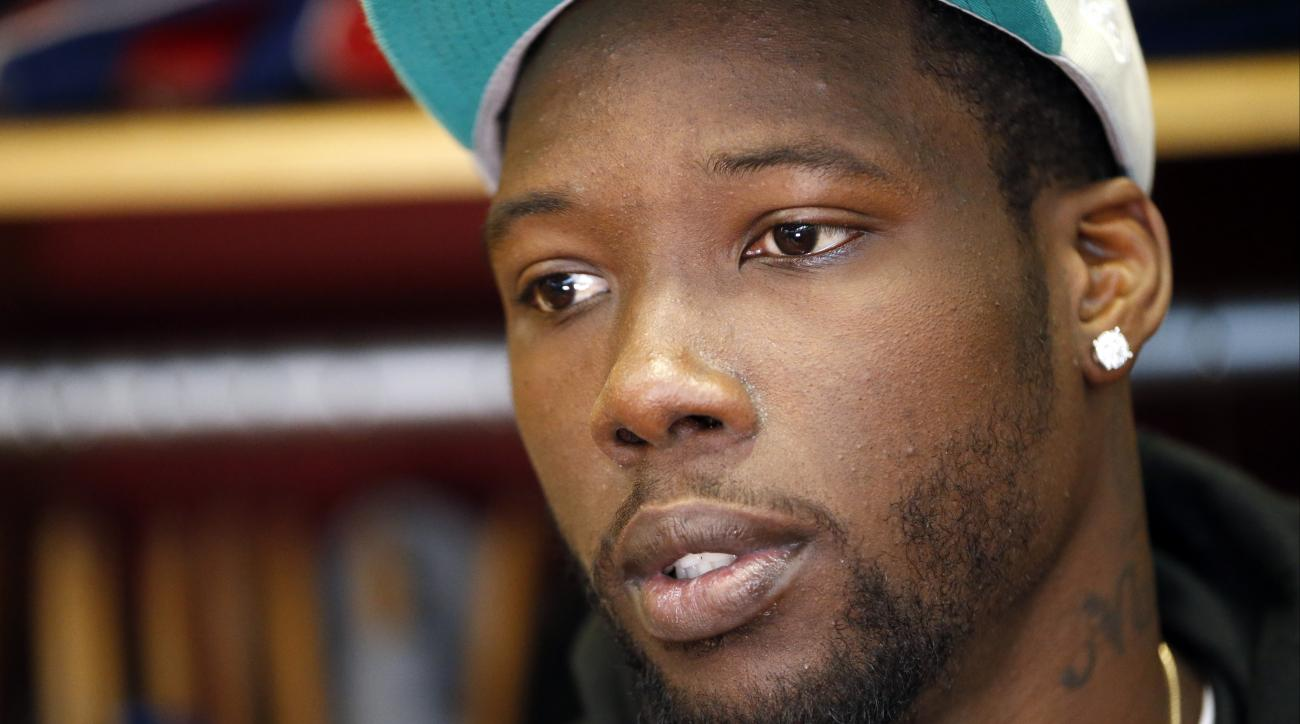 FILE - In this Oct. 30, 2015, file photo, New York Giants defensive end Jason Pierre-Paul speaks to reporters for the first time since injuring his hand, in East Rutherford, N.J. Almost a year after mangling his right hand in a fireworks accident, Pierre-
