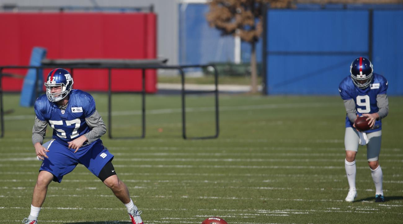 New York Giants long snapper Danny Aiken, left, and punter Brad Wing work out during NFL football practice, Thursday, Dec. 10, 2015, in East Rutherford, N.J. (AP Photo/Julio Cortez)