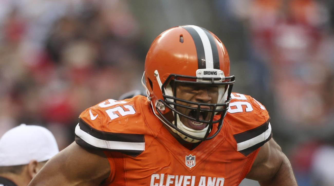 FILE - In this Dec. 13, 2015, file photo, Cleveland Browns defensive end Desmond Bryant reacts after sacking San Francisco 49ers quarterback Blaine Gabbert during the second half of an NFL football game, in Cleveland. Browns starting defensive end Desmond