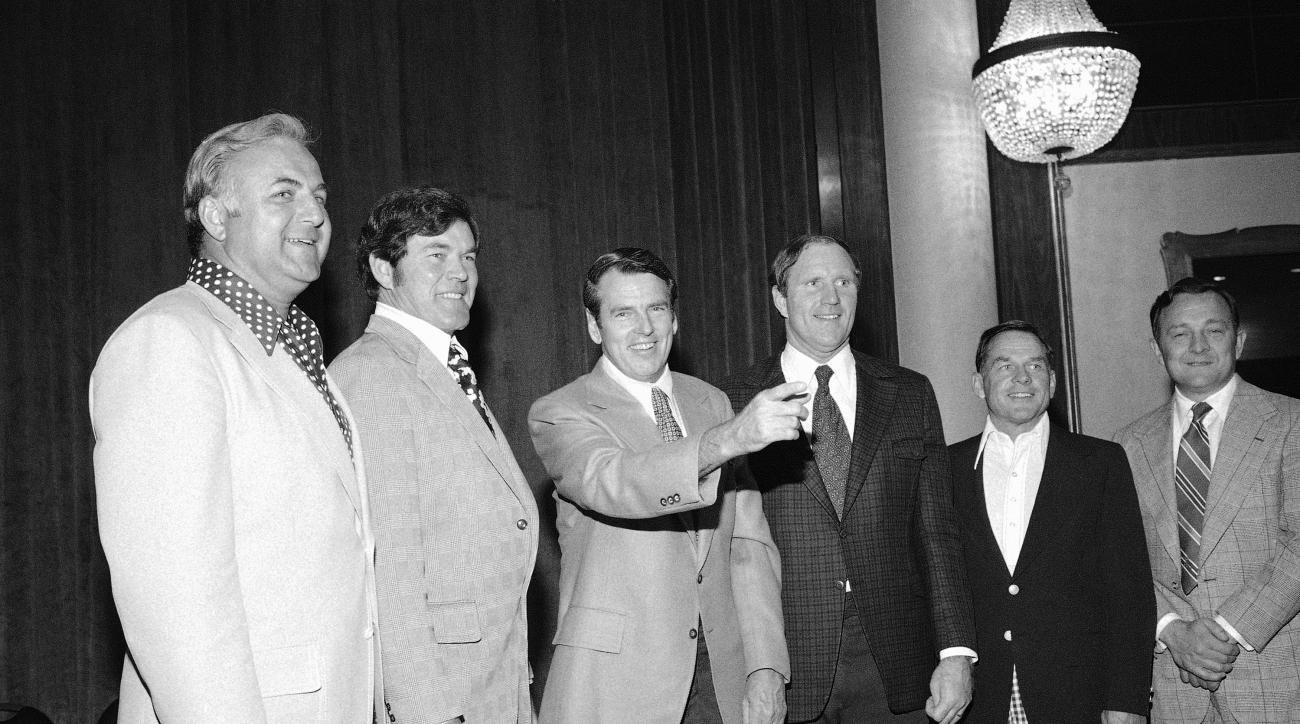 FILE - In this May 12, 1975, file photo, George Allen, third from left, head coach of the Washington Redskins, is pictured with five of his former assistants in New York. From left are: Mike McCormack, Philadelphia Eagles; Marion Campbell, Atlanta Falcons
