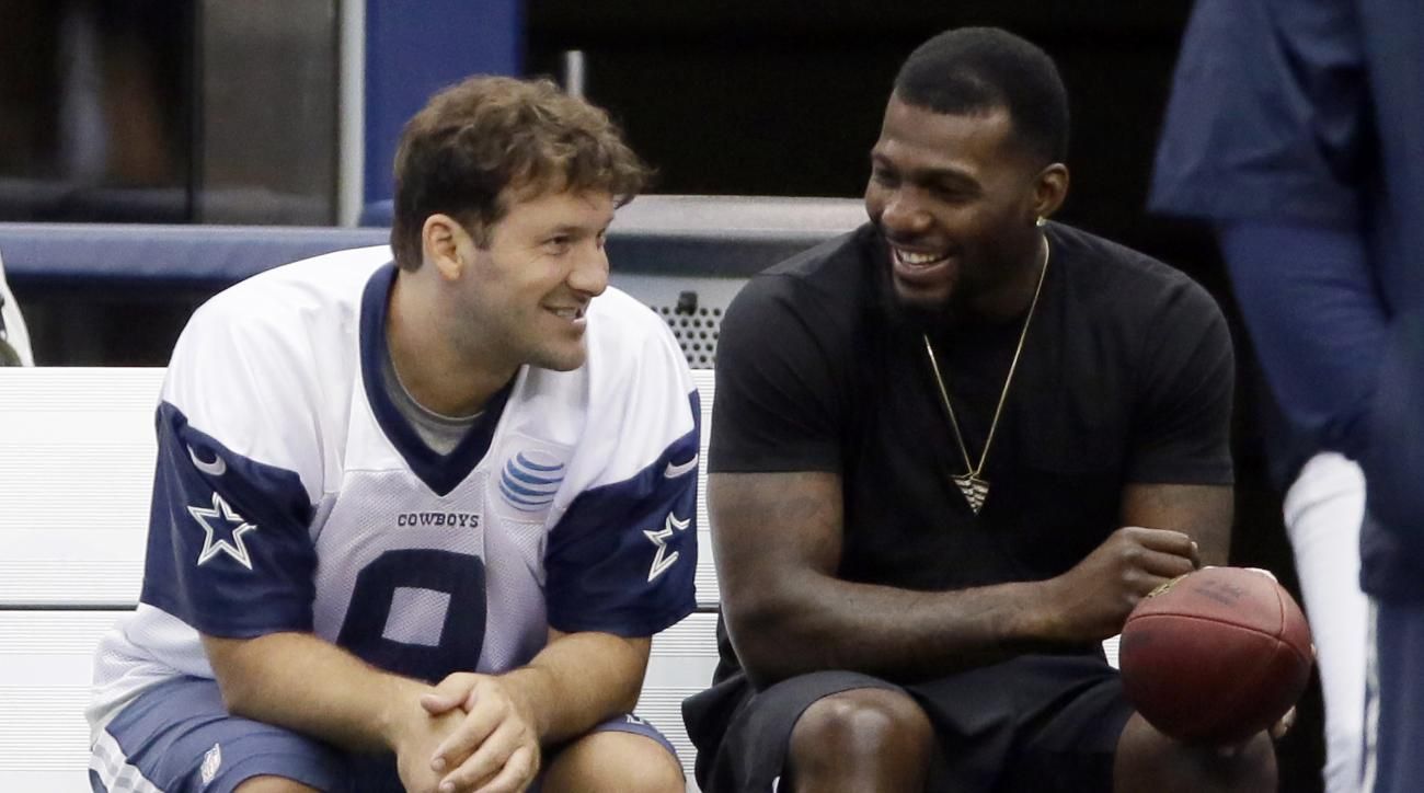 FILE - In this June 18, 2015, file photo, Dallas Cowboys wide receiver Dez Bryant, right, sits on the bench with quarterback Tony Romo (9) during NFL football minicamp at the team's stadium in Arlington, Texas. Both are anxious to get on the field togethe