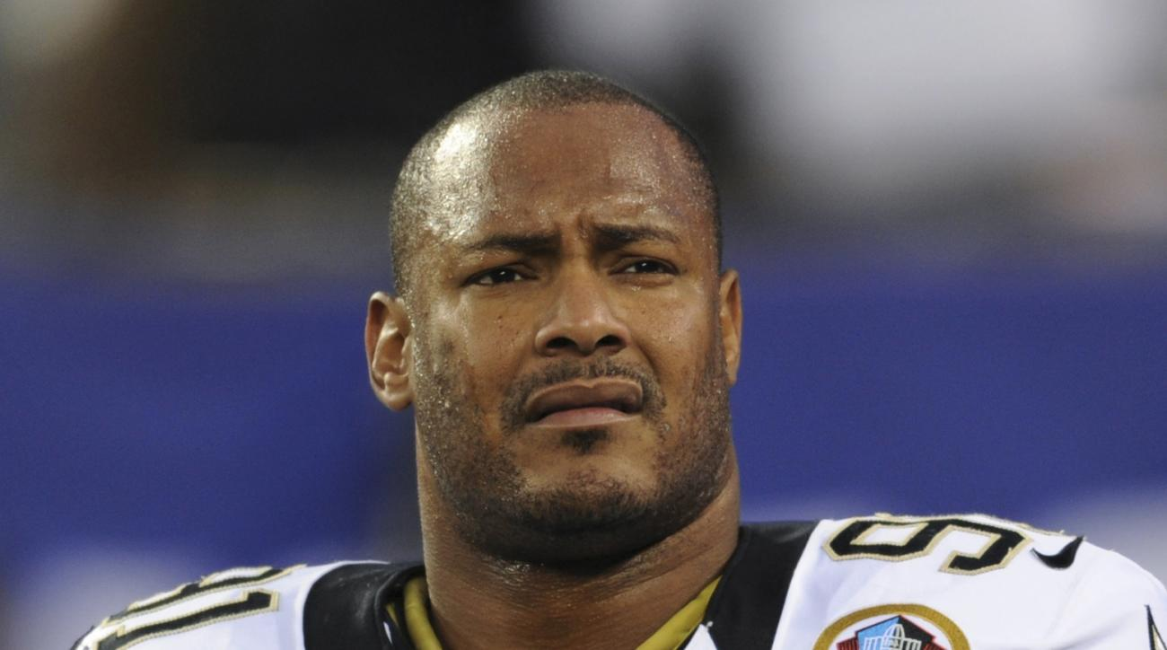 FILE - In this Dec. 9, 2012, file photo, New Orleans Saints defensive end Will Smith appears before an NFL football game against the New York Giants in East Rutherford, N.J. A judge in New Orleans postponed until Friday, July 22, 2016, a hearing on whethe