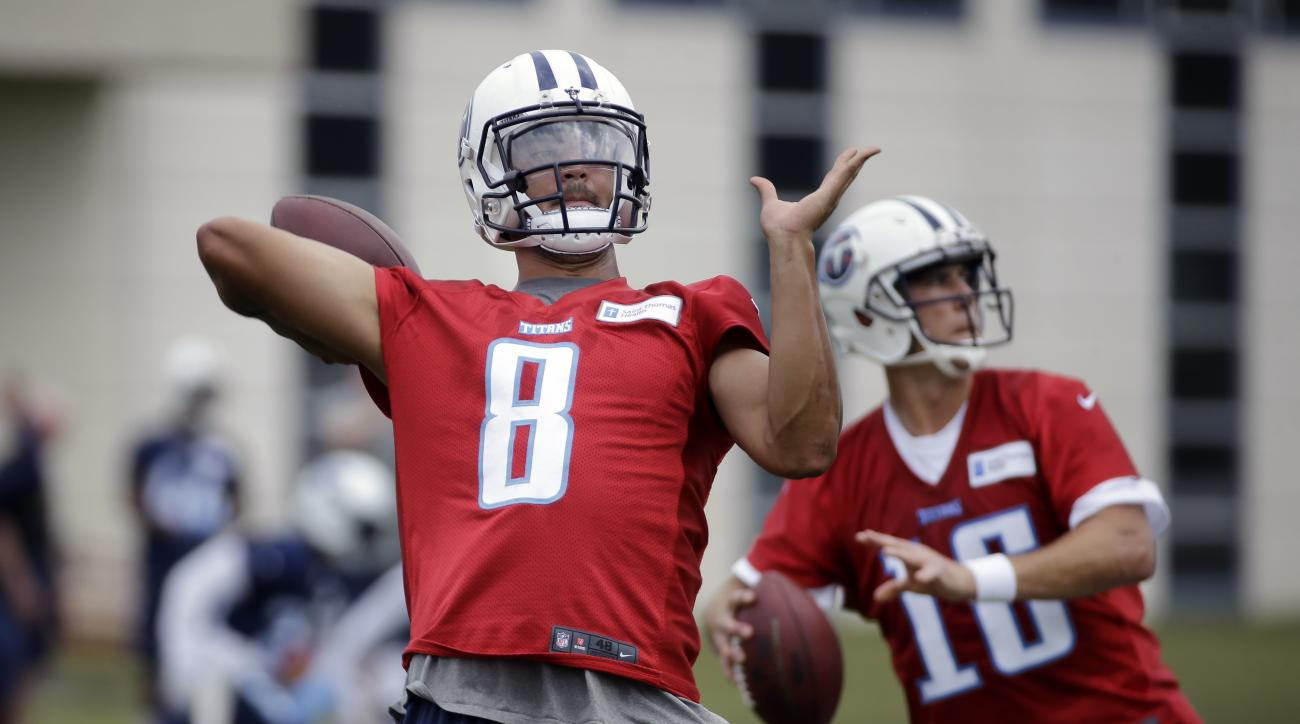FILE - In this May 26, 2016, file photo, Tennessee Titans quarterbacks Marcus Mariota (8) and Matt Cassel (16) run a drill during an NFL football practice in Nashville, Tenn. Mariota sees a noticeable upgrade in the talent around him when he looks around