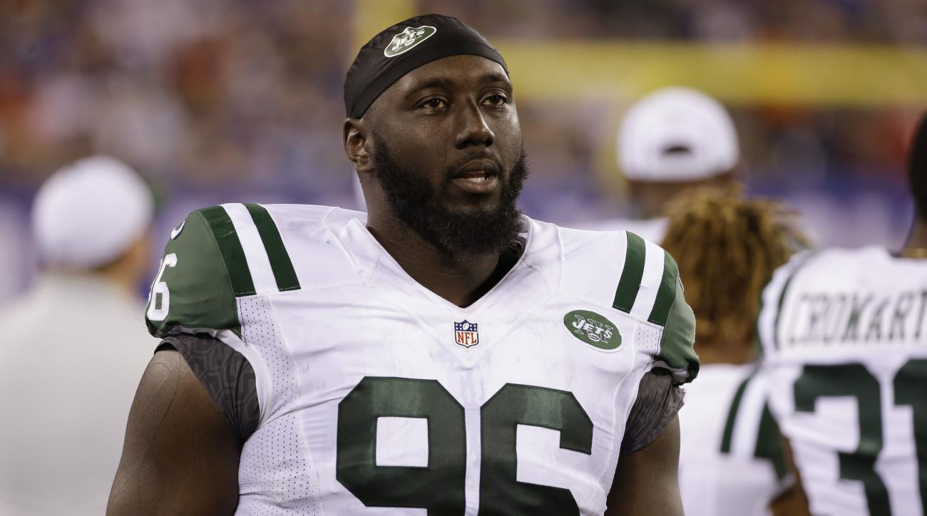FILE - In this Aug. 29, 2015 file photo, New York Jets defensive end Muhammad Wilkerson (96) walks the sidelines during the second half of a preseason NFL football game against the New York Giants in East Rutherford, N.J. The Pro Bowl defensive end, still