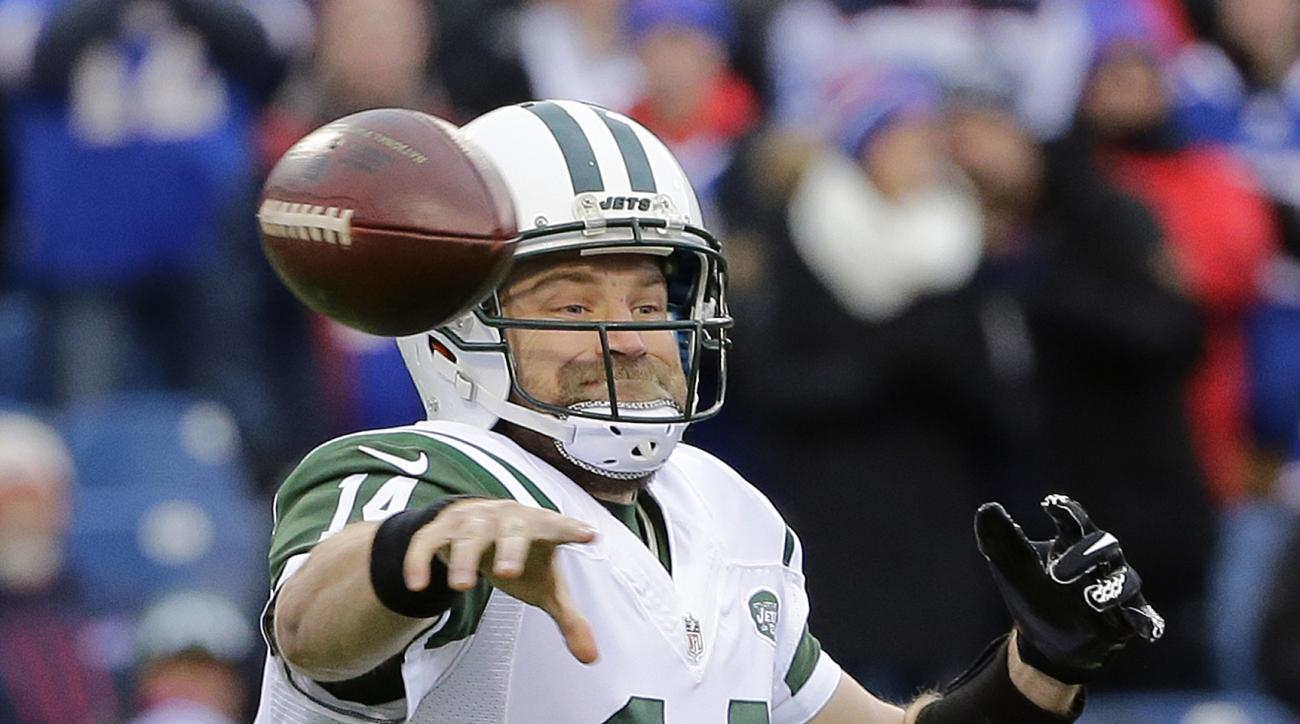 FILE - In this Jan. 3, 2016, file photo, New York Jets quarterback Ryan Fitzpatrick (14) throws a pass during the first half of an NFL football game against the Buffalo Bills in Orchard Park, N.Y. The New York Jets are heading to training camp with their