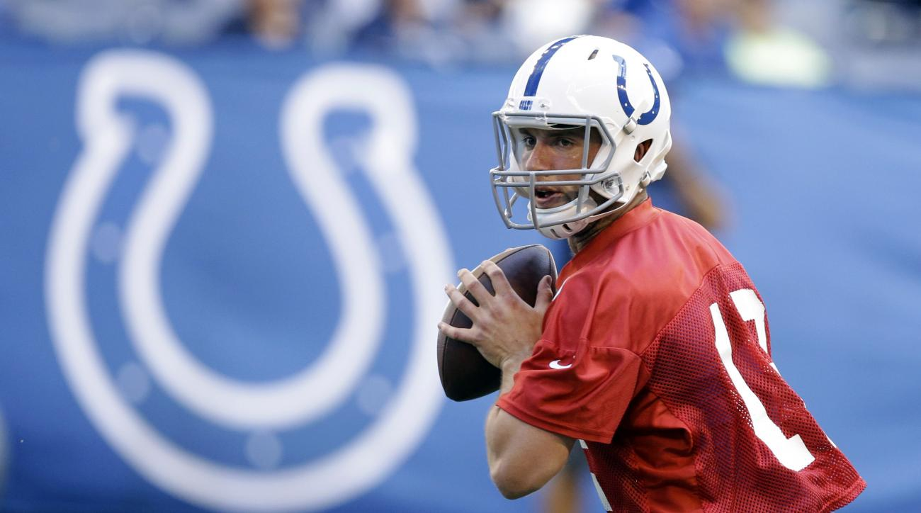 FILE - In this June 8, 2016, file photo, Indianapolis Colts' Andrew Luck runs a drill during an NFL football practice, in Indianapolis. Nobody can expect perfection, but a year ago the offensive line was the Colts most glaring problem.  (AP Photo/Darron C