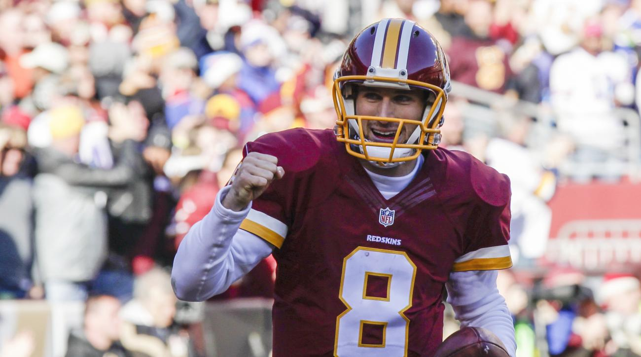 FILE - In this Dec. 20, 2015, file photo, Washington Redskins quarterback Kirk Cousins (8) celebrates his touchdown during the first half of an NFL football game against the Buffalo Bills in Landover, Md. One place theres no competition is at quarterback,
