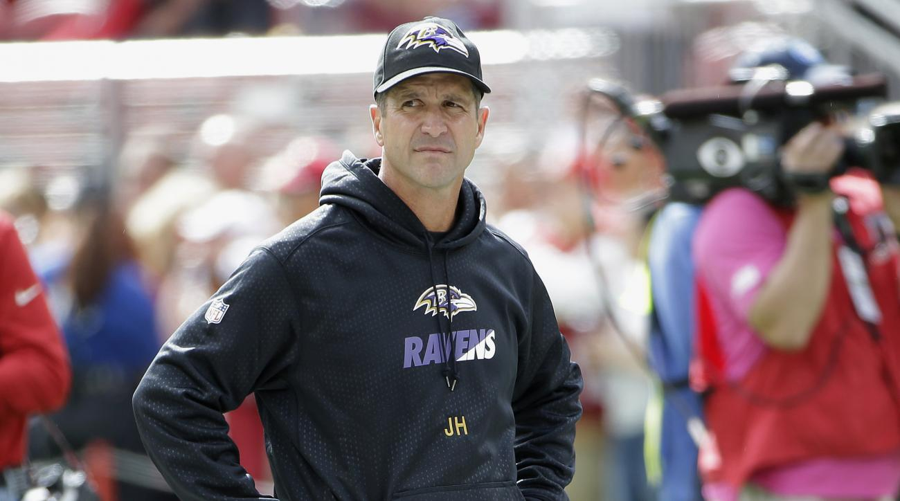 FILE - In this Oct. 18, 2015, file photo, Baltimore Ravens head coach John Harbaugh looks out over the field before an NFL football game against the San Francisco 49ers in Santa Clara, Calif. Baltimore placed 20 players on injured reserve while stumbling