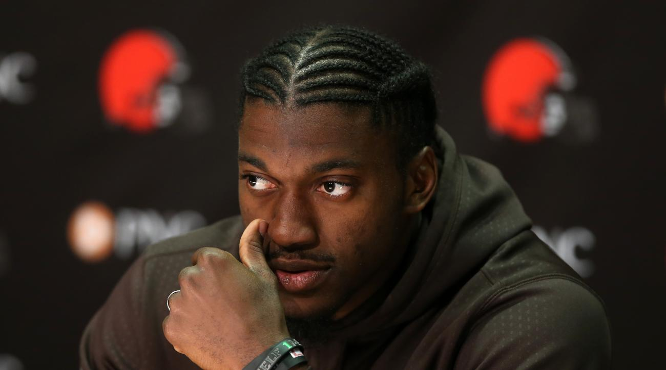 FILE  - In this April 6, 2016, file photo, Cleveland Browns quarterback Robert Griffin III answers a question during a news conference at the practice facility in Berea, Ohio. The Browns, with a laughable track record for developing quarterbacks, signed G