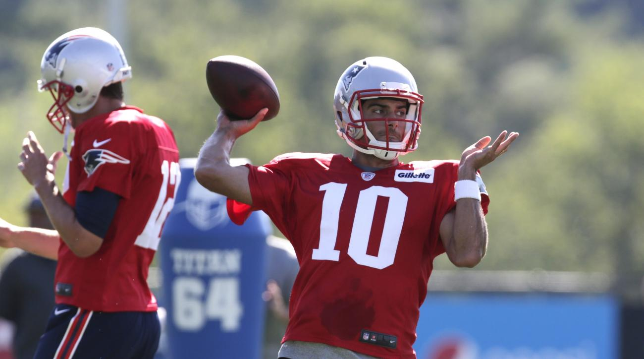 FILe - In thie July 31, 2015, file photo, New England Patriots quarterback Jimmy Garappolo throws during an NFL football training camp in Foxborough, Mass. The Patriots will open camp July 27 knowing the cornerstone of their franchise wont be available fo