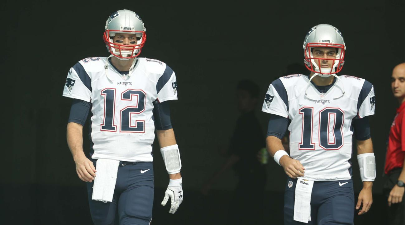 FILe - In this Jan. 3, 2016, file photo, New England Patriots quarterbacks Tom Brady (12) and Jimmy Garoppolo (10) enter the field before an NFL football game against the Miami Dolphins, in Miami Gardens, Fla. The Patriots will open camp July 27 knowing t