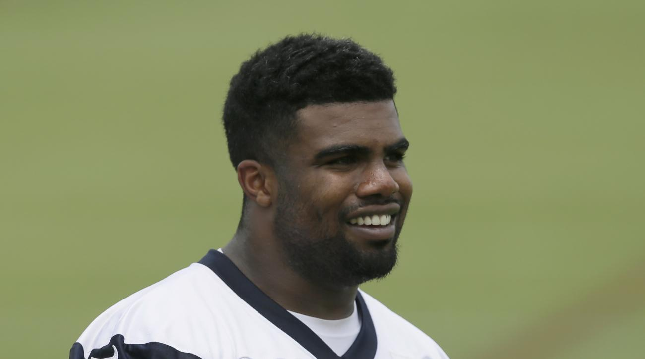 Dallas Cowboys running back Ezekiel Elliott (21) walks the field during the NFL football team's minicamp at Valley Ranch in Irving, Texas, Tuesday, June 14, 2016. (AP Photo/LM Otero)