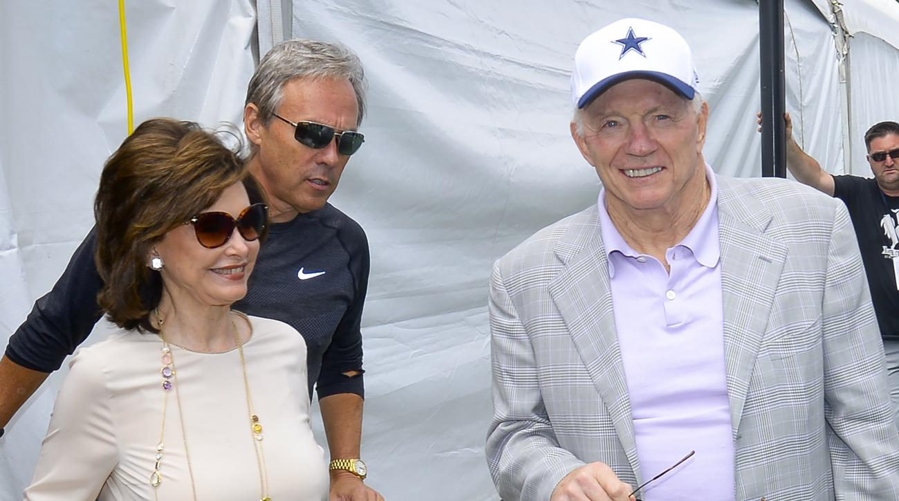 "(left to right) Wife Eugenia Jones, Dallas Cowboys owner Jerry Jones and team spokesman Rich Dalrymple arrive at the ""state of the team"" news conference during the start of Dallas Cowboys' NFL training camp, Wednesday, July 29, 2015, in Oxnard, Calif. (AP"