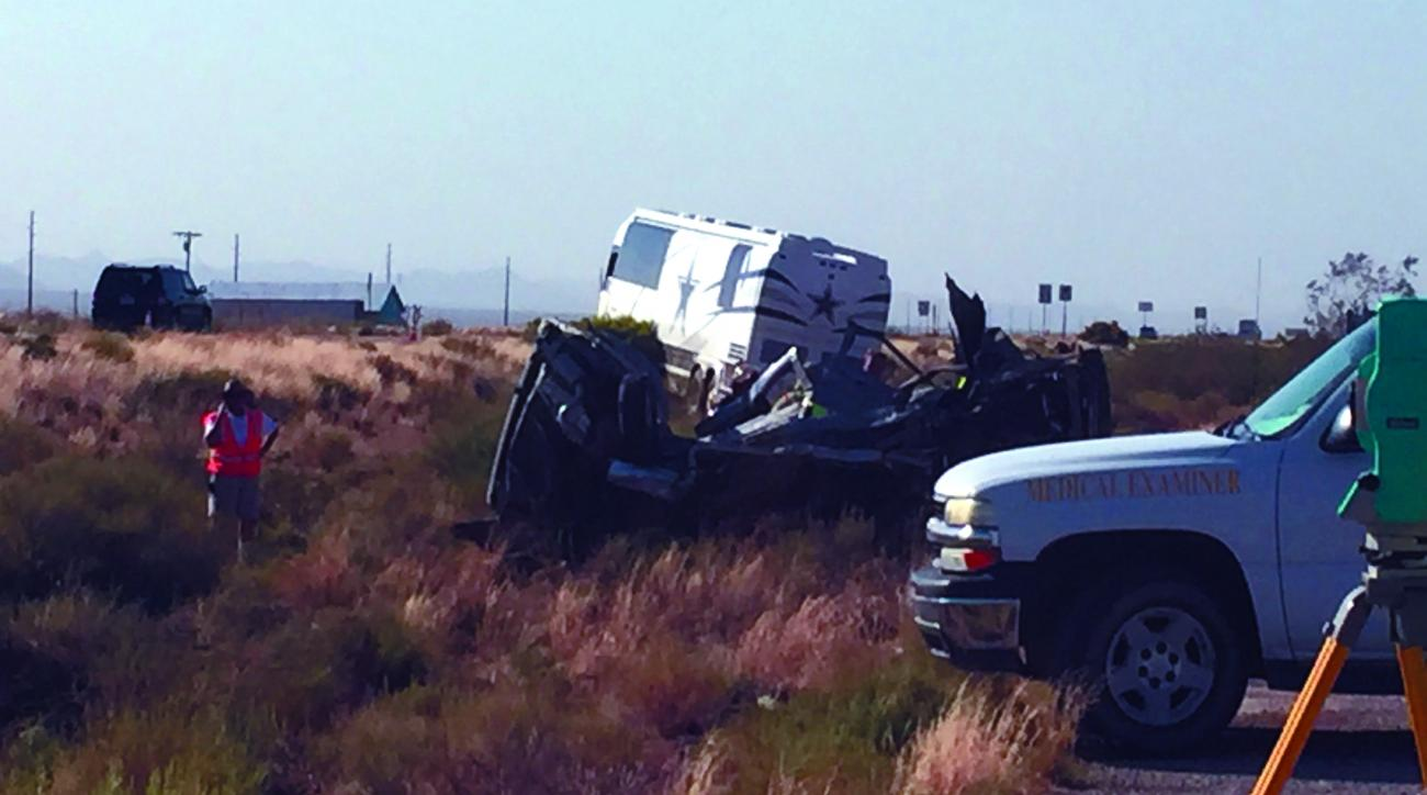 The scene of a bus crash is surveyed Sunday, July 24, 2016, on a highway in northwestern Arizona. A Dallas Cowboys bus collided with another vehicle and authorities say at least one person was killed. Team spokesman Rich Dalrymple confirmed a Cowboys bus
