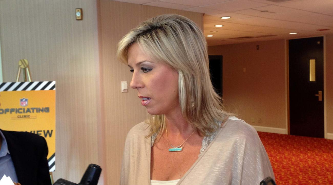 Sarah Thomas, the first female to be a full-time game official in the NFL, talks with reporters about her first season while at the annual NFL Officiating Clinic on Friday, July 15, 2016, in Irving, Texas. Thomas will again be the NFL's only female game o