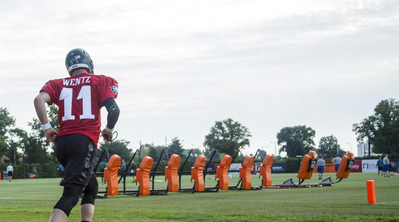 Philadelphia Eagles quarterback Carson Wentz takes the field during practice at NFL football training camp, Monday, July 25, 2016, in Philadelphia. (AP Photo/Chris Szagola)