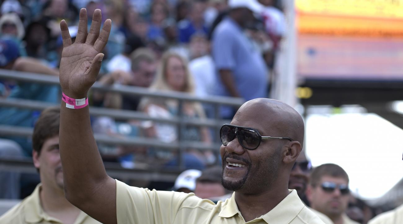 FILe - In this Nov. 30, 2014, file photo, former Jacksonville Jaguars receiver Jimmy Smith waves to fans from the sideline during the first half of an NFL football game against the New York Giants in Jacksonville, Fla. Retired receiver Jimmy Smith, whose