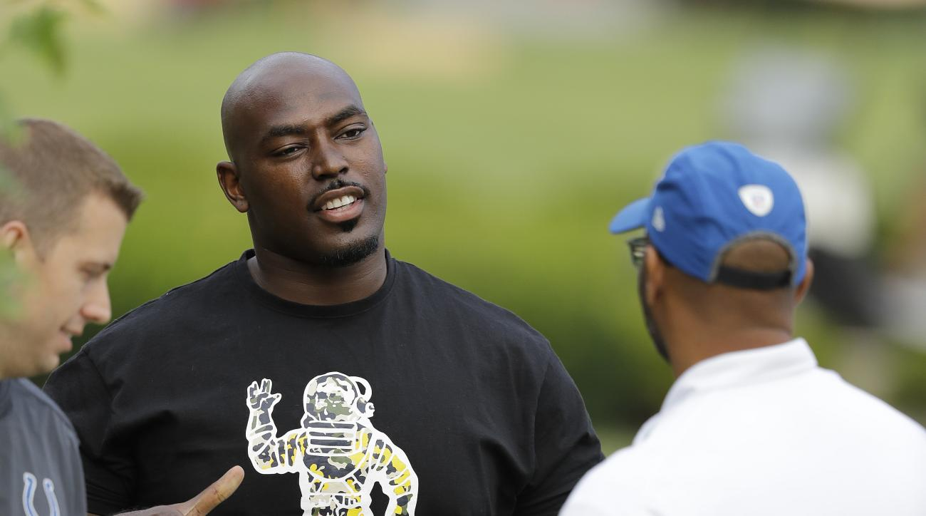 Indianapolis Colts defensive lineman Arthur Jones, center, greets Avis Roper after arriving for an NFL football training camp, Tuesday, July 26, 2016, in Anderson, Ind. (AP Photo/Darron Cummings)