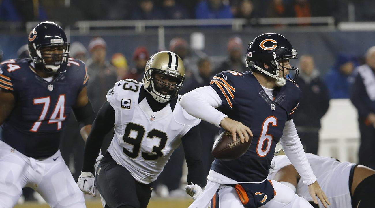 FILE - In this Dec. 15, 2014 file photo, New Orleans Saints outside linebacker Junior Galette (93) chases Chicago Bears quarterback Jay Cutler (6) before a sack during the first half of an NFL football game in Chicago. Washington Redskins linebacker Junio