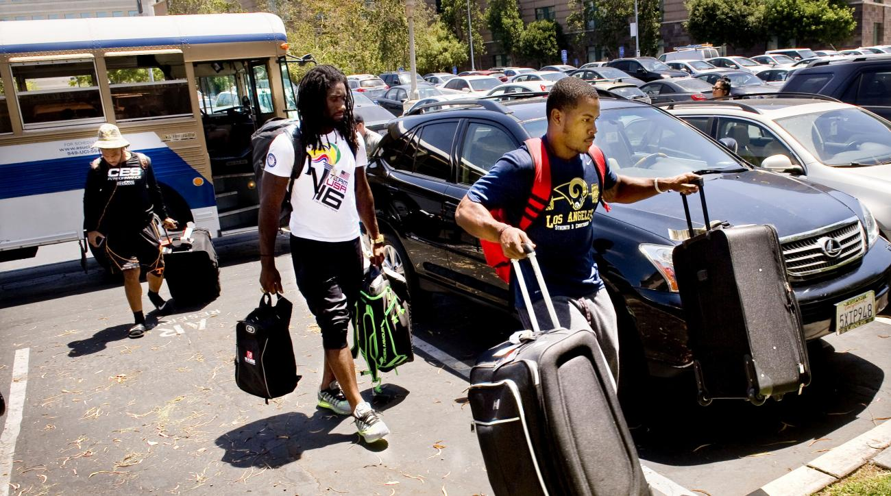 Los Angeles Rams rookie cornerback Rohan Gaines, right, carries his bags to check in for NFL football training camp at the University of California, Irvine after getting off a bus Tuesday, July 26, 2016, in Irvine, Calif. Paul Rodriguez/The Orange County