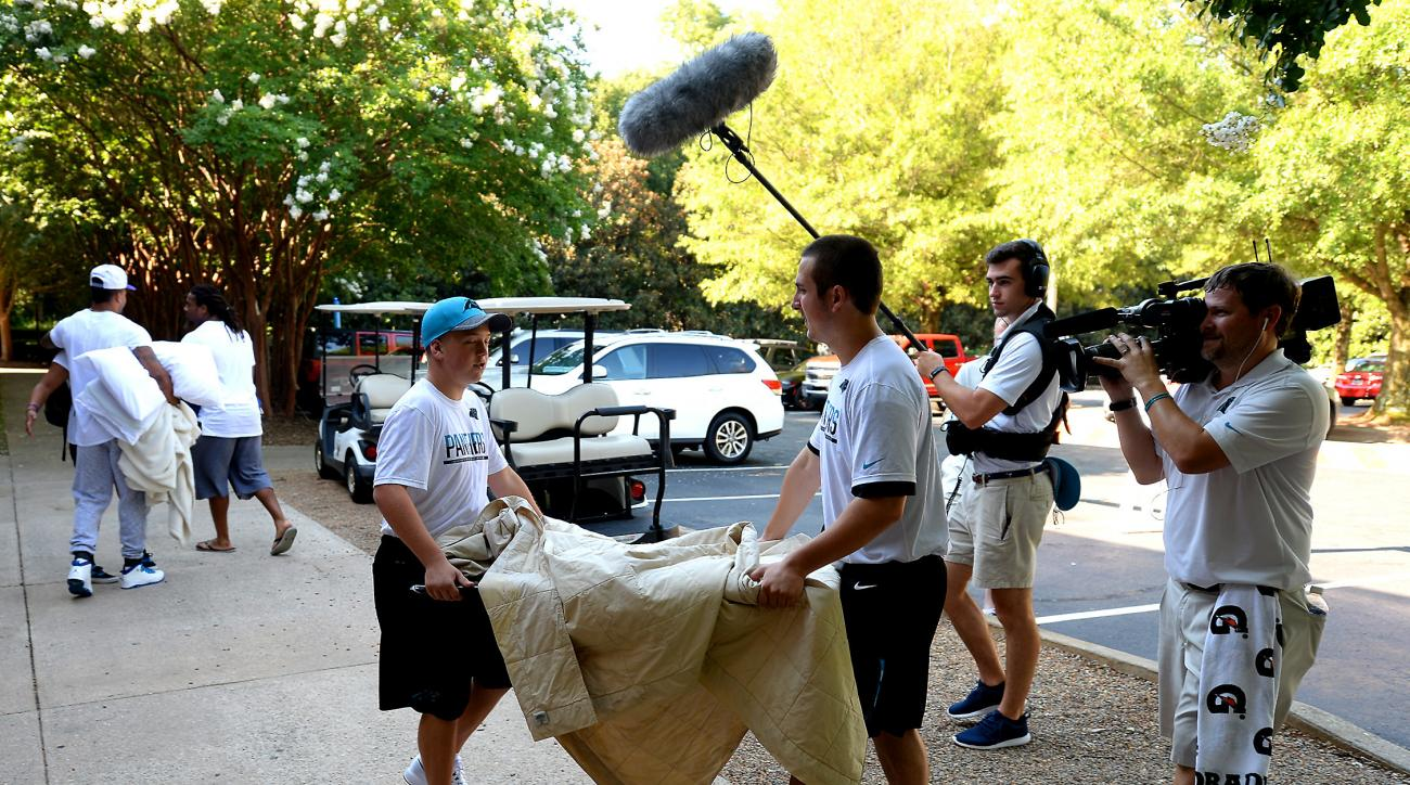 Great attention and care is given to a flat screen TV being delivered to a Carolina Panthers dorm room at Wofford College in Spartanburg, SC on Wednesday, July 27, 2016. (Jeff Siner /The Charlotte Observer via AP)