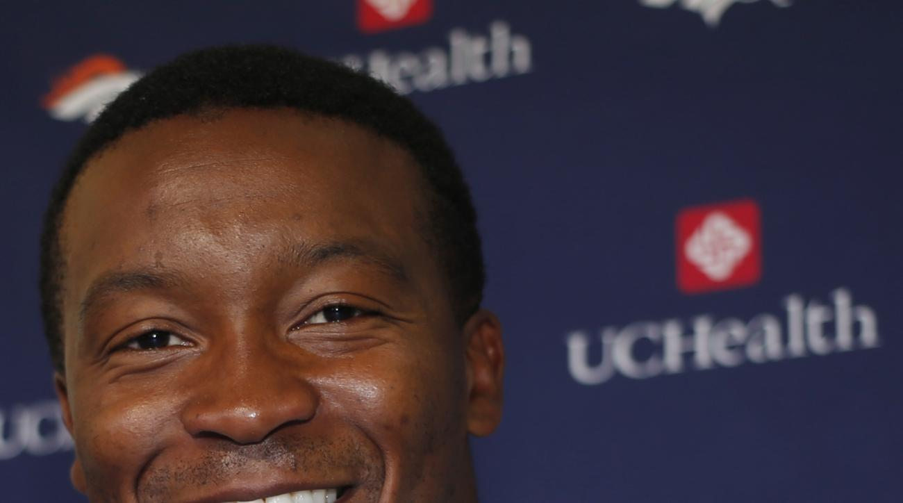 Denver Broncos wide receiver Demaryius Thomas smiles as he waits to respond to a question during a news conference before the team's opening of training camp Wednesday, July 27, 2016 in Englewood, Colo. (AP Photo/David Zalubowski)
