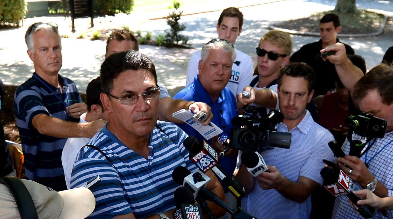 Carolina Panthers head coach Ron Rivera, right, listens to a reporter's question on Wednesday, July 27, 2016. The Panthers returned to Wofford College in Spartanburg, SC to begin training camp. (Jeff Siner/The Charlotte Observer via AP)