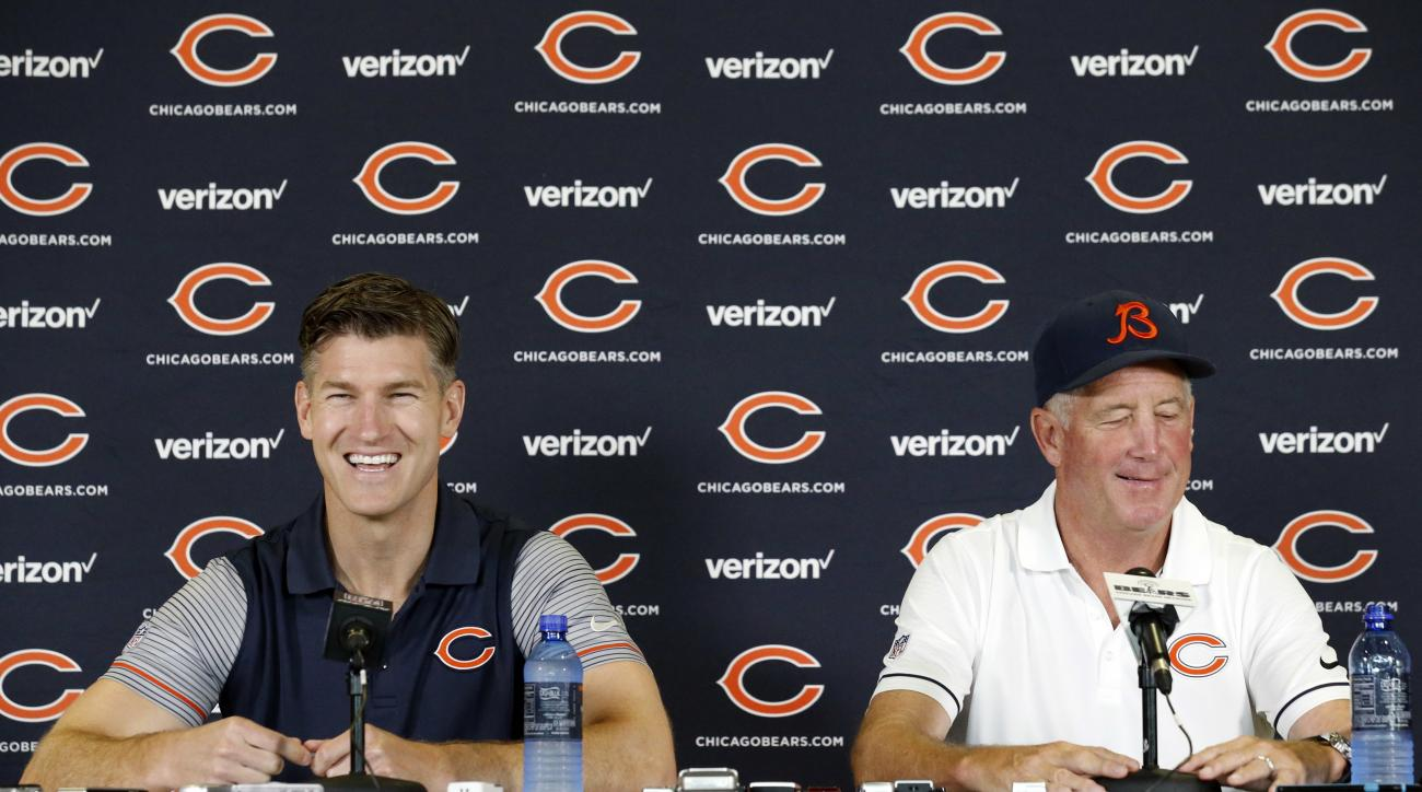 Chicago Bears general manager Ryan Pace, left, and head coach John Fox smile as they listen to a question at a news conference during team's NFL football training camp at Olivet Nazarene University, Wednesday, July 27, 2016, in Bourbonnais, Ill. (AP Photo