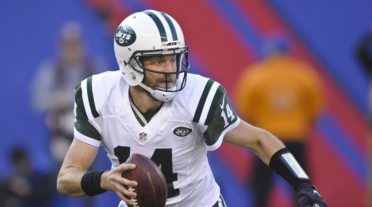 FILE - In this Dec. 6, 2015, file photo, New York Jets quarterback Ryan Fitzpatrick looks to pass during an NFL football game against the New York Giants in East Rutherford, N.J. A person familiar with the negotiations says the Jets have re-signed Fitzpat