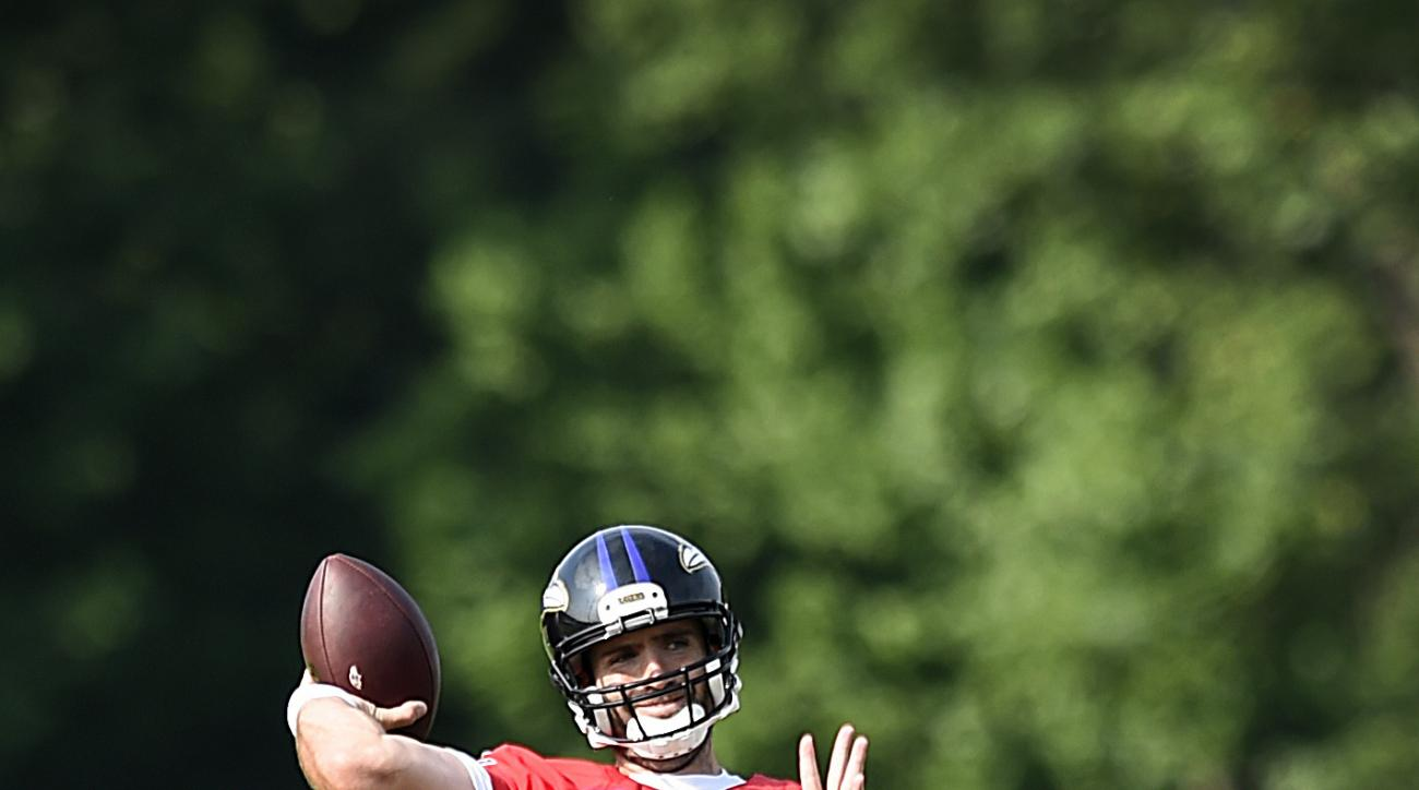 Baltimore Ravens quarterback Joe Flacco throws a pass during practice at the NFL football teams training camp in Owings Mills, MD., Thursday, July 28, 2016. (AP Photo/Gail Burton)