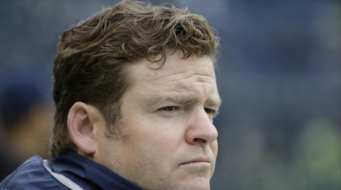 FILE - In this Oct. 18, 2015, file photo, Seattle Seahawks general manager John Schneider watches warmups before an NFL football game against the Carolina Panthers, in Seattle. Schneider speaks Thursday, July 28, 2016,  about his new contract extension, a