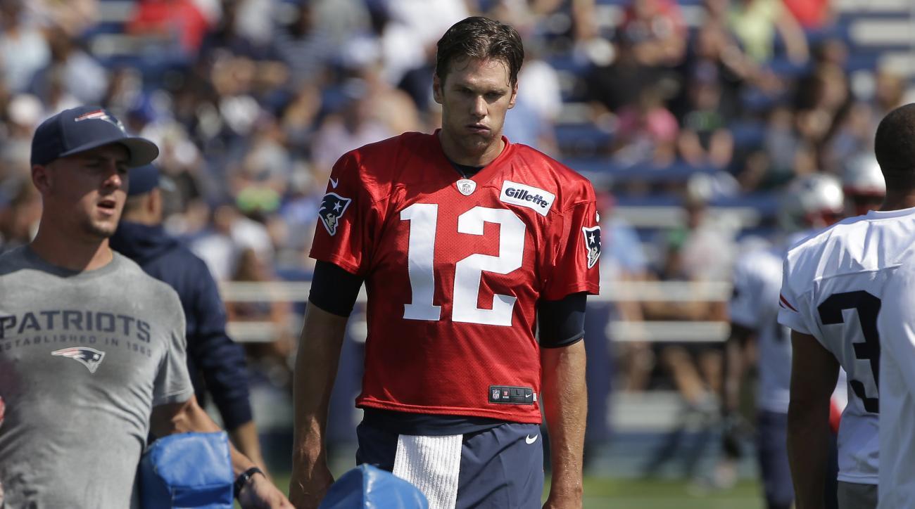 New England Patriots quarterback Tom Brady (12) walks on the field during an NFL football training camp practice Thursday, July 28, 2016, in Foxborough, Mass. (AP Photo/Steven Senne)