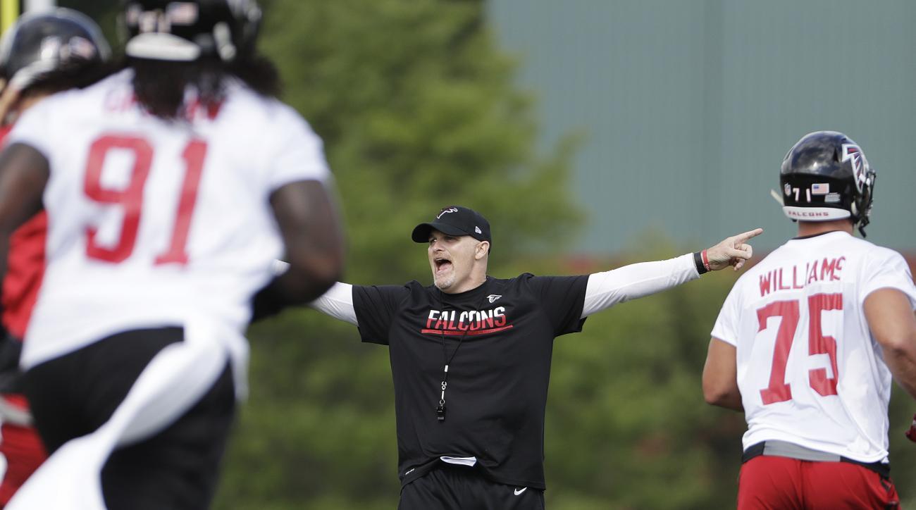 Atlanta Falcons head coach Dan Quinn shouts to players during the team's NFL football training camp Thursday, July 28, 2016, in Flowery Branch, Ga. (AP Photo/David Goldman)