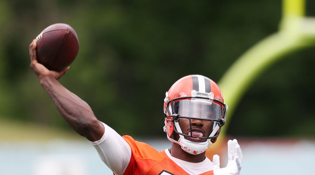 File- This June 7, 2016, file photo shows Cleveland Browns quarterback Robert Griffin III throwing during NFL football mini camp at the practice facility in Berea, Ohio.  Cleveland Browns coach Hue Jackson said he will name his starting quarterback for th