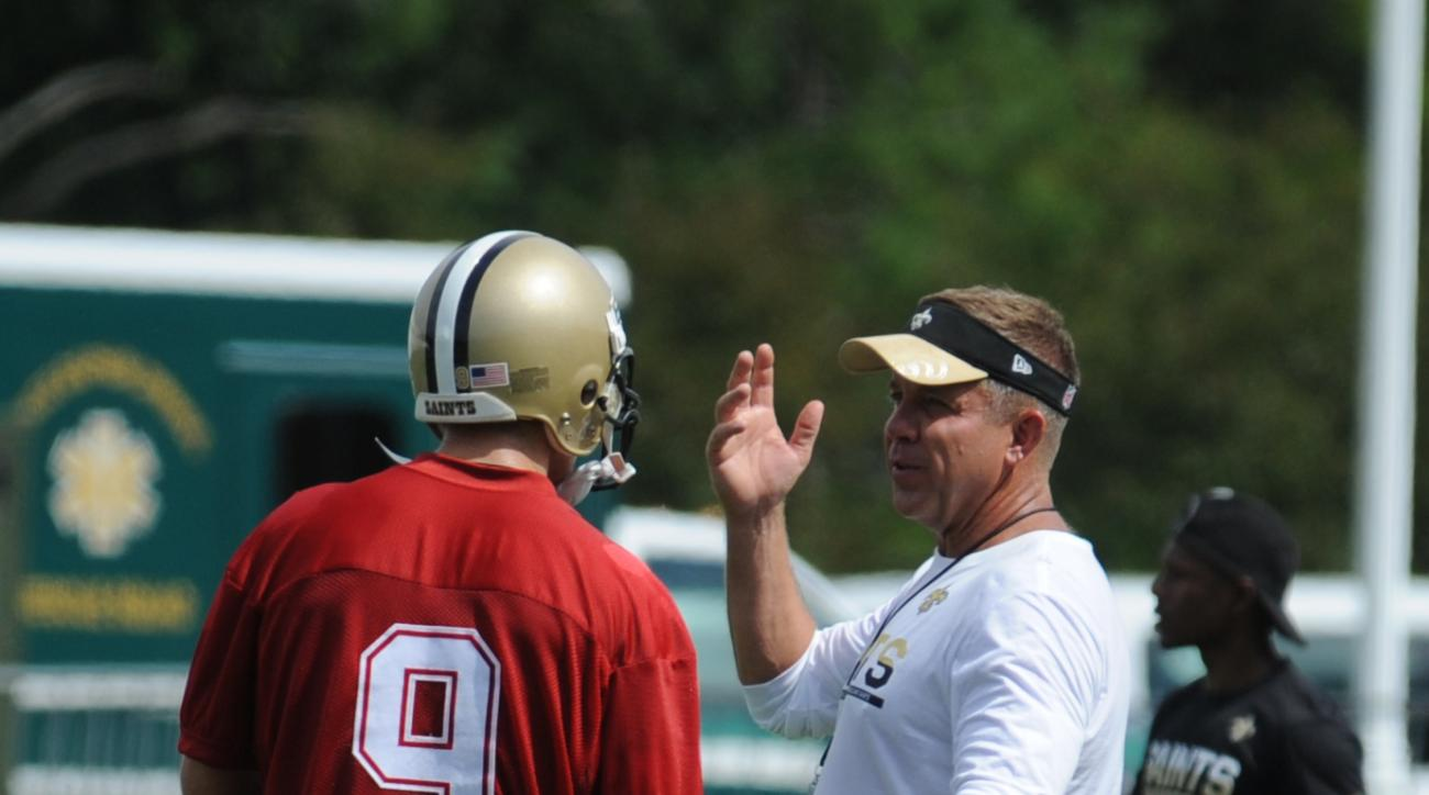 New Orleans Saints quarterback Drew Brees (9) talks with head coach Sean Payton during the NFL football teams  training camp in White Sulphur Springs, W.Va., Thursday, July 28, 2016. (AP Photo/Chris Tilley)