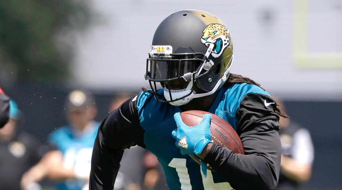 Jacksonville Jaguars running back Denard Robinson gains yardage in a scrimmage during NFL football training camp, Thursday, July 28, 2016, in Jacksonville, Fla. (AP Photo/John Raoux)