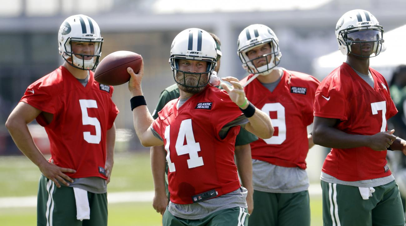 New York Jets quarterback Ryan Fitzpatrick (14) throws the ball as quarterbacks Christian Hackenberg (5), Bryce Petty (9) and Geno Smith (7) look on during NFL football training camp, Thursday, July 28, 2016, in Florham Park, N.J. (AP Photo/Julio Cortez)