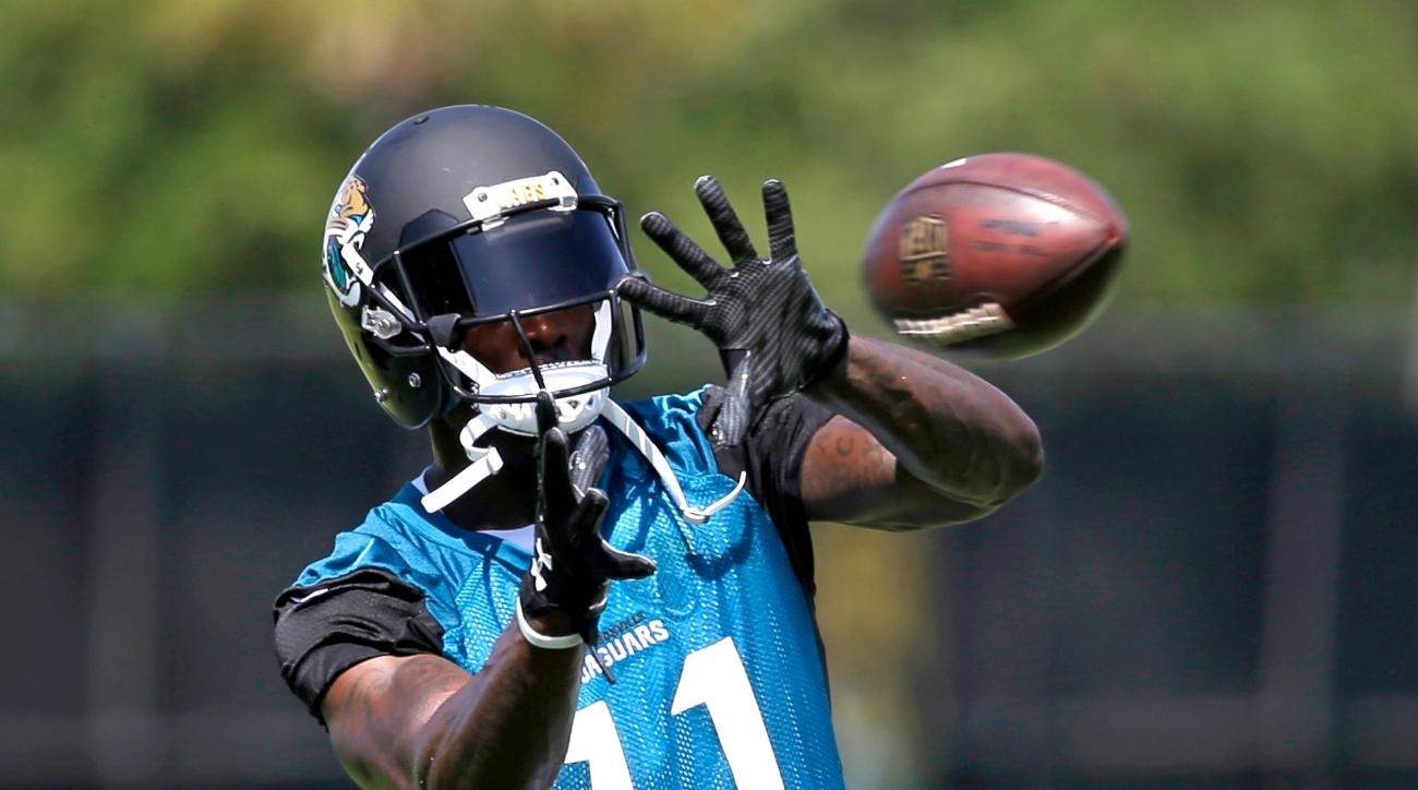 Jacksonville Jaguars wide receiver Marqise Lee makes a catch during NFL football training camp, Thursday, July 28, 2016, in Jacksonville, Fla. (AP Photo/John Raoux)