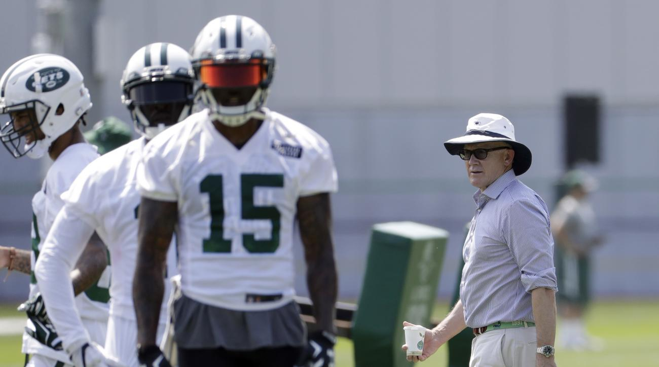 New York Jets owner Woody Johnson, right, looks on as wide receiver Brandon Marshall (15) and teammates run a drill during NFL football training camp, Thursday, July 28, 2016, in Florham Park, N.J. (AP Photo/Julio Cortez)