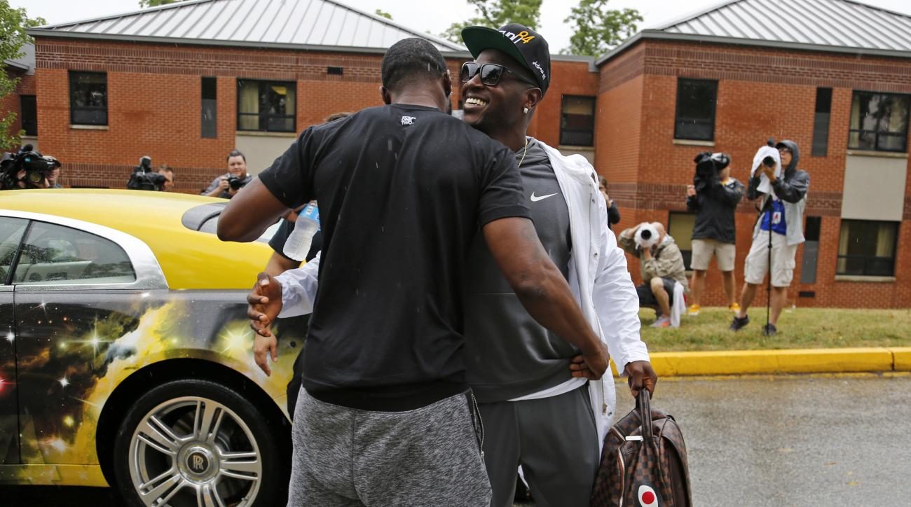 Pittsburgh Steelers wide receiver Antonio Brown, right, arrives for NFL football camp at the team training facility in Latrobe, Pa. on Thursday, July 28, 2016. (AP Photo/Gene J. Puskar)