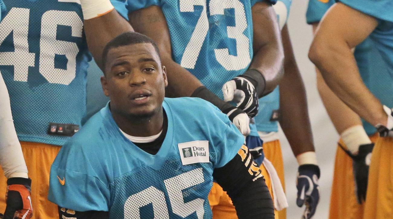 FILE - In this June 2, 2014, file photo, Miami Dolphins defensive end Dion Jordan (95) is shown during football practice in Davie, Fla. Dolphins defensive end Dion Jordan has been reinstated by the NFL on a conditional basis after sitting out last season