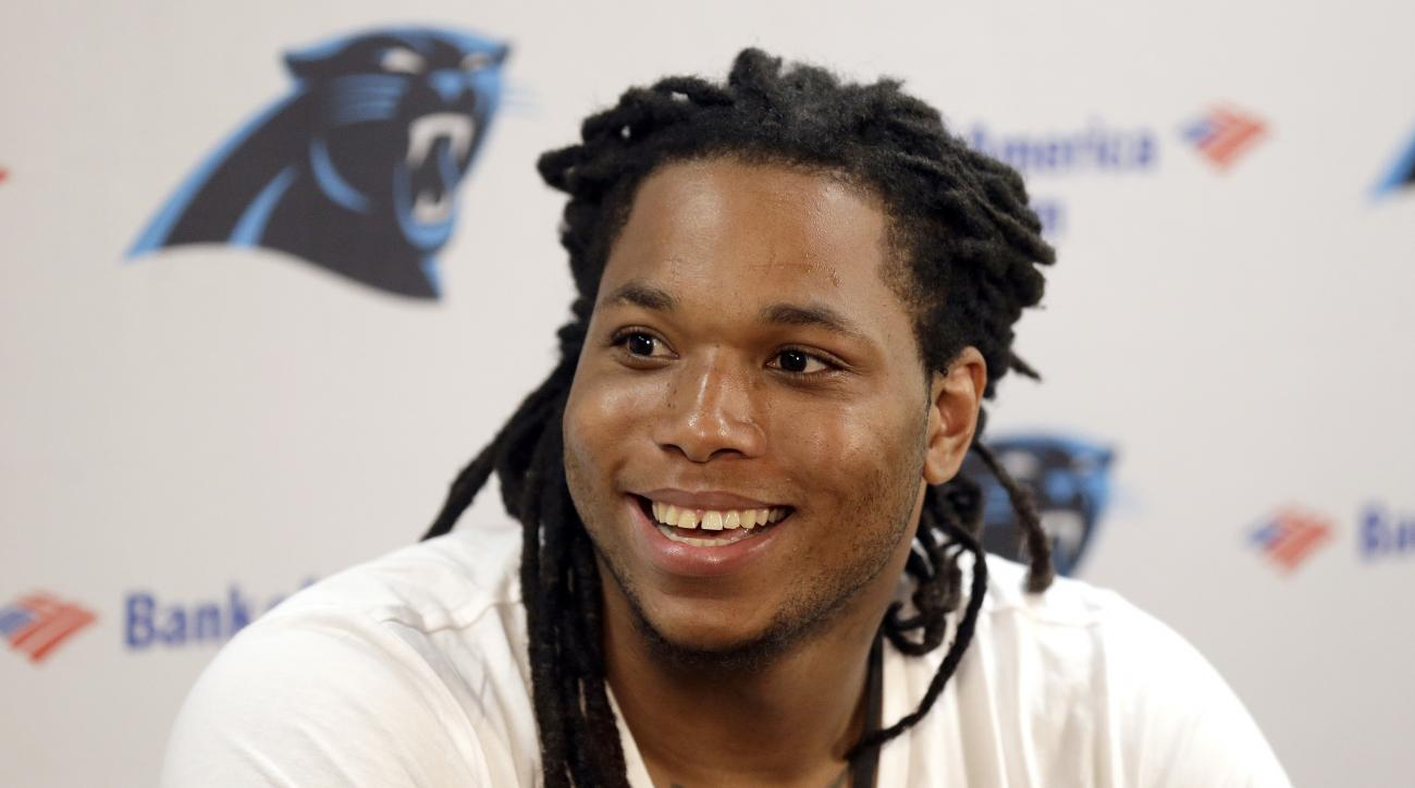 Carolina Panthers wide receiver Kelvin Benjamin smiles while responding to a question during a press conference at the NFL football team's training camp in Spartanburg, S.C., Friday, July 29, 2016. (AP Photo/Gerry Broome)