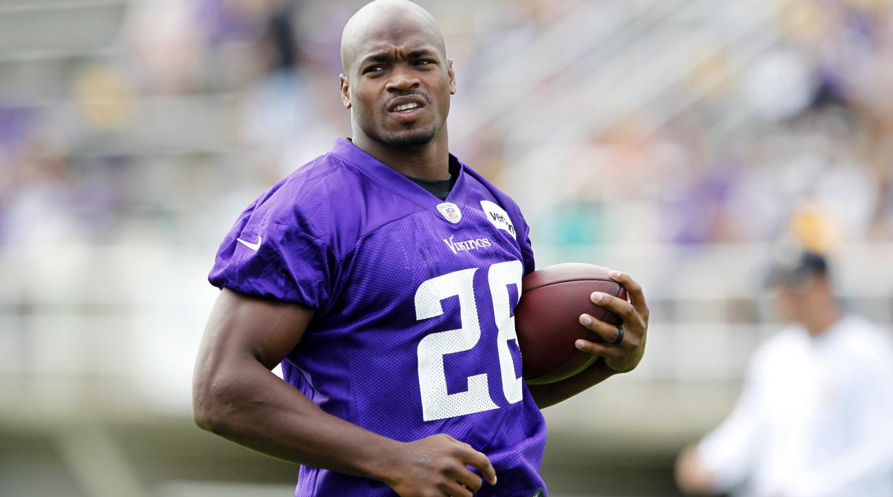 Minnesota Vikings running back Adrian Peterson (28) runs with the ball during the first day of NFL football training camp at Mankato State University in Mankato, Minn. on Friday, July, 29, 2016.(AP Photo/Andy Clayton-King)